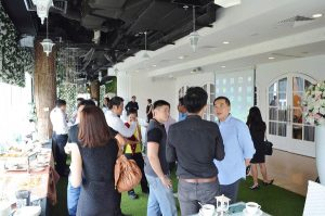 CEO Signature Event - Attendees Chatting with Timotheus